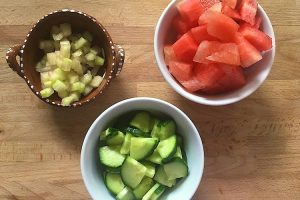 Chopped watermelon cucumber and rind in bowls