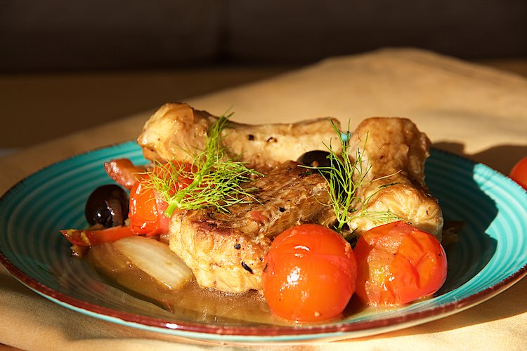 Mediterranean dogfish with fennel, peppers and tomatoes