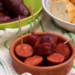 Spanish chorizo in red wine or chorizo in vino tinto served with baguette