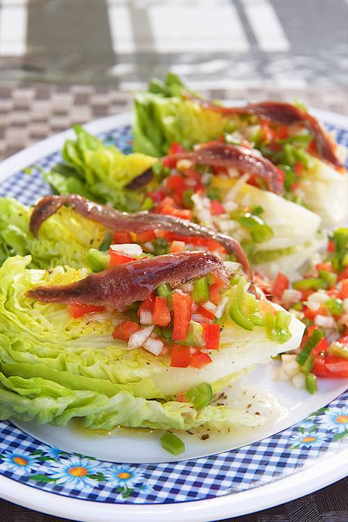 Little Gem lettuce anchovies long shot on a checkered plate