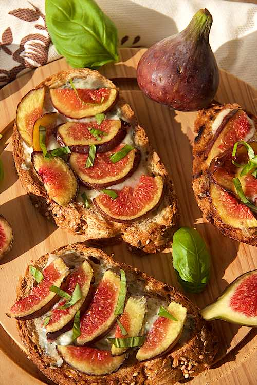 slices of bruschetta with fig and blue cheese or fig crostini with blue cheese