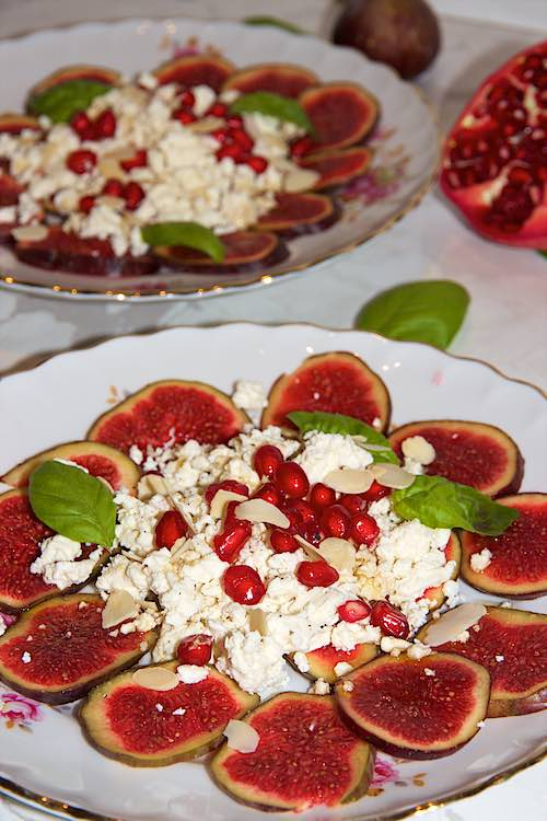 long view of almond pomegranate salad with fresh fig and feta