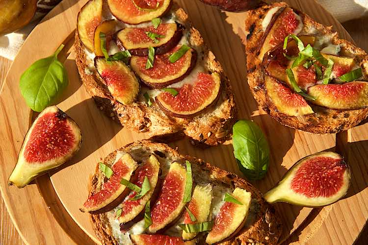 gorgonzola with warm fig bruschetta with fresh figs and basil leaves