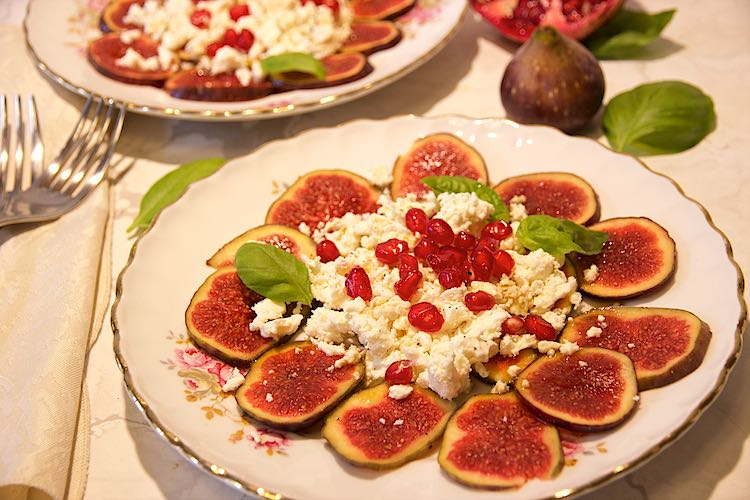 Fresh fig and feta salad with pomegranate and basil leave with honey balsamic dressing