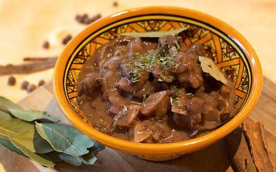 Wild boar stew with mushrooms