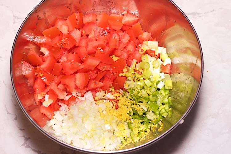 chopped tomato onion spring onion and chillis for a salad