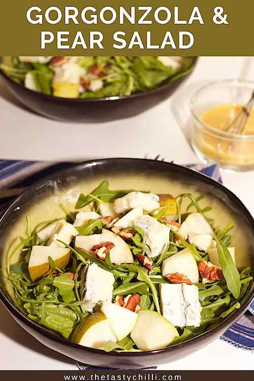 bowl of pear gorgonzola salad with pecans and honey mustard dressing pin