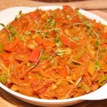 close up of south african chakalaka with beans, tomatoes, onions, cabbage and spices