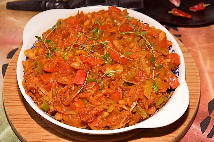 close up view of chakalaka recipe from south africa with chilli, bell pepper, onions, cabbage and tomatoes