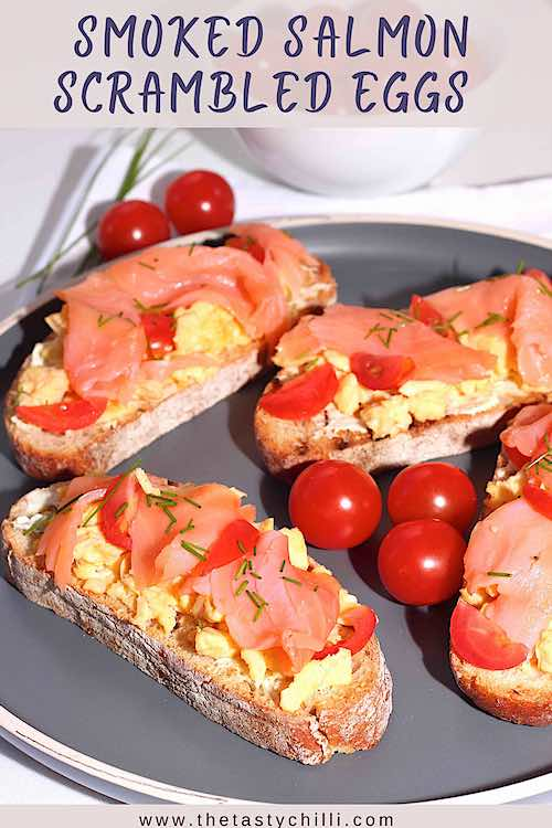Smoked salmon scrambled eggs on toast with cherry tomatoes and chives