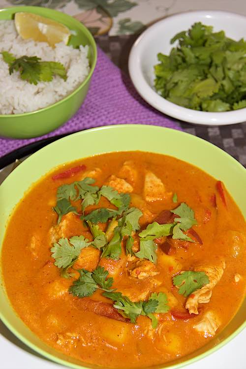 long shot mango chicken curry with rice cilantro and lime